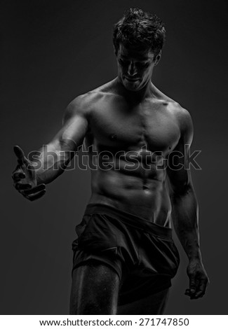 Portrait of handsome  man with naked torso. Isolated on gray background.