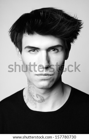 Portrait of handsome man with stylish haircut - stock photo