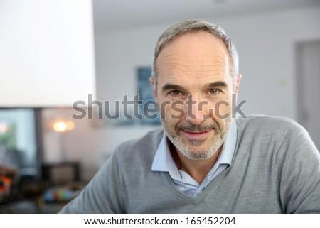 Portrait of handsome mature man - stock photo
