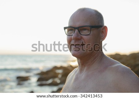 Portrait of handsome mature man outdoors near beach