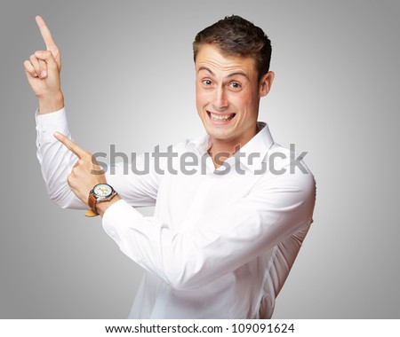Portrait Of Handsome Mature Man Pointing Up Over On A Gray Background - stock photo