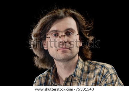Portrait of handsome men with long hair. Isolated on black background. - stock photo