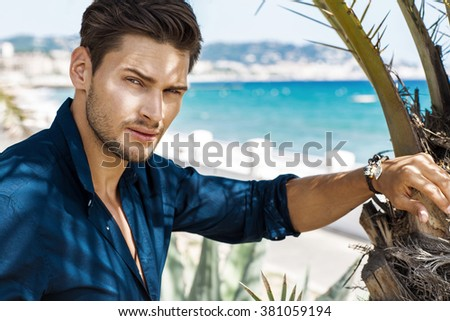Portrait of handsome model with sea view - stock photo