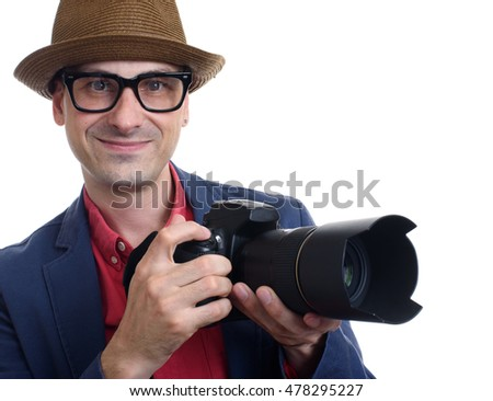 portrait of handsome photographer holding a camera. Isolated