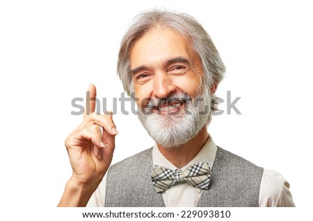 Portrait of handsome senior caucasian man with gray beard and bowtie has an idea pointing finger up isolated on white background - stock photo