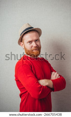 Portrait of handsome serious redhead man in hat - stock photo