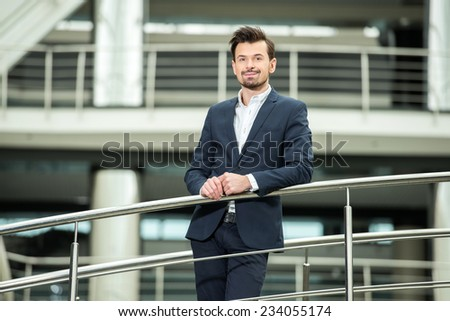 Portrait of handsome, smiling, confident businessman is looking at the camera.
