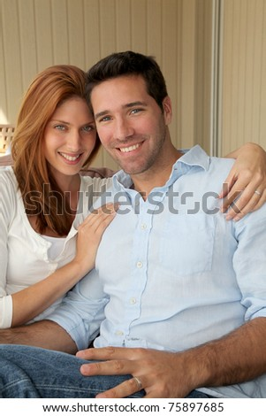 Portrait of handsome smiling couple - stock photo