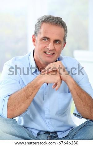 Portrait of handsome smiling mature man - stock photo