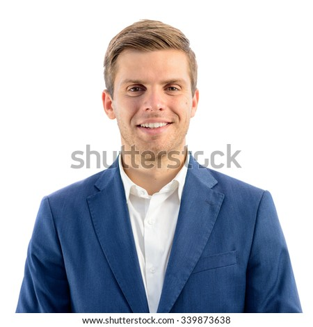 Portrait of Handsome Smiling Young Businessman Standing on the White Background and Looking at Camera
