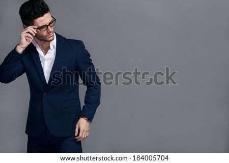 Portrait of handsome stylish man in elegant suit - stock photo