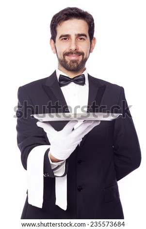 Portrait of handsome waiter holding an empty tray over white background