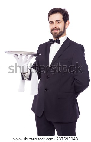 Portrait of handsome waiter holding an empty tray over white background - stock photo
