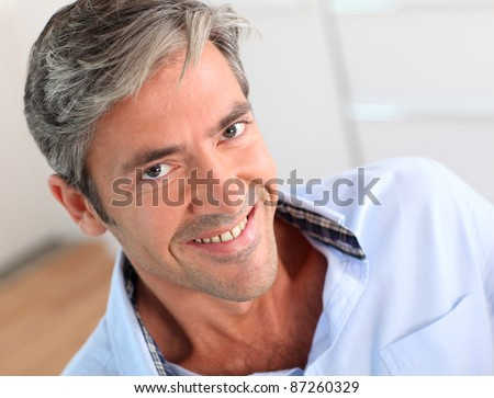 Portrait of handsome 40-year-old man - stock photo