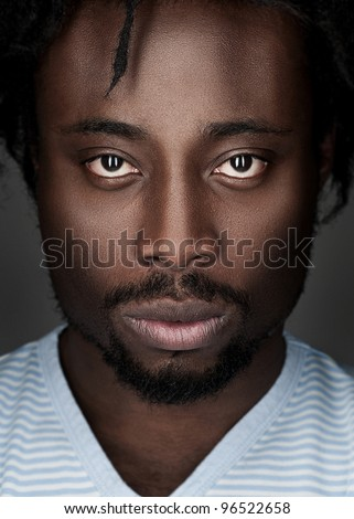 Portrait of handsome young african american man looking at camera - stock photo