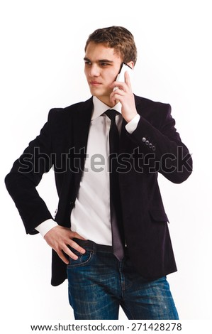 Portrait of handsome young business man using cell phone, smiling - stock photo