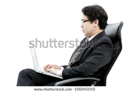 Portrait of handsome young business man using computer