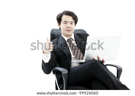 Portrait of handsome young business man using new laptop and showing hand sign
