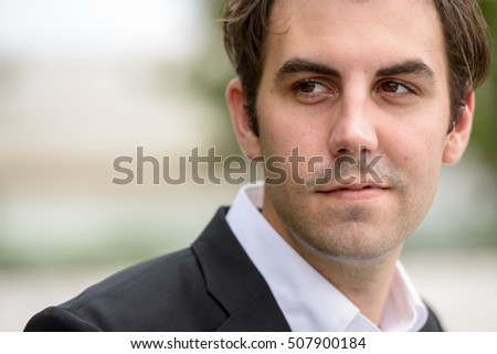 Portrait of handsome young businessman outdoors