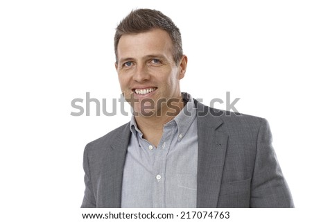 Portrait of handsome young businessman smiling happy.
