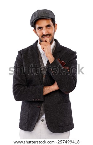 Portrait of handsome young indian man standing his hand on chin against white background  - stock photo