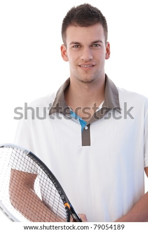 Portrait of handsome young male tennis player, smiling.? - stock photo