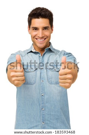 Portrait of handsome young man gesturing thumbs up while standing against white background. Vertical shot. - stock photo