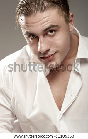 Portrait of handsome young man in white shirt