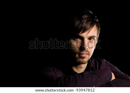 Portrait of handsome young man on a black background