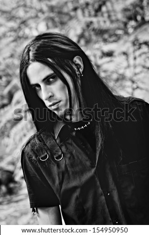 Portrait of  handsome young man with long hair. Black and white - stock photo