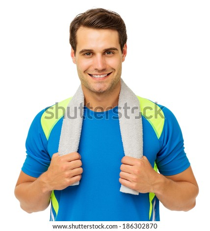 Portrait of handsome young man with towel around neck over white background. Horizontal shot. - stock photo