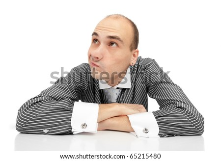 Portrait of handsome young thoughtful businessman - stock photo