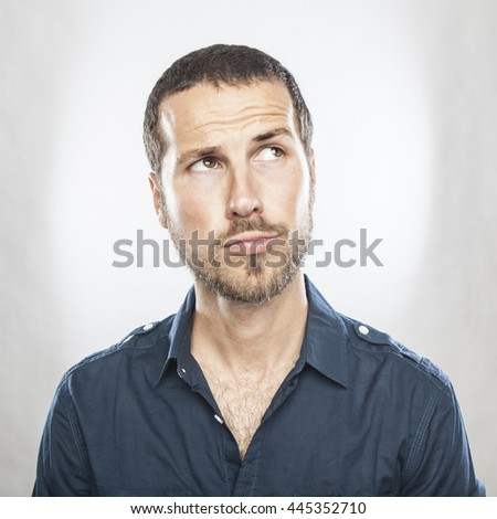 Portrait of handsome young thoughtful man isolated over white background