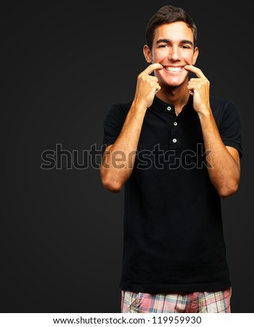 Portrait Of Happy A Boy against a black background - stock photo