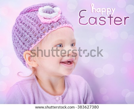 Portrait of happy adorable child wearing cute knitted hat on pink blur background, greeting card with text space, happy Easter holiday - stock photo