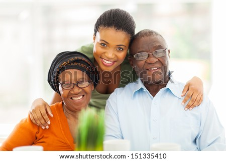 portrait of happy african family at home - stock photo
