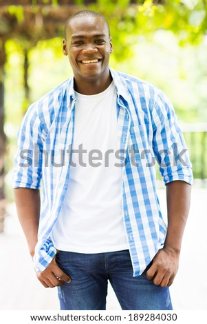 portrait of happy african man outdoors - stock photo
