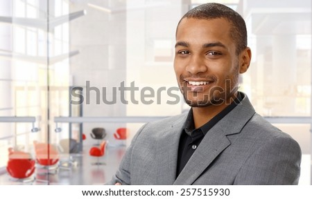 Portrait of happy afro-american businessman at office. - stock photo
