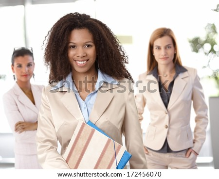 Portrait of happy afro-american businesswoman and female colleagues at office. - stock photo