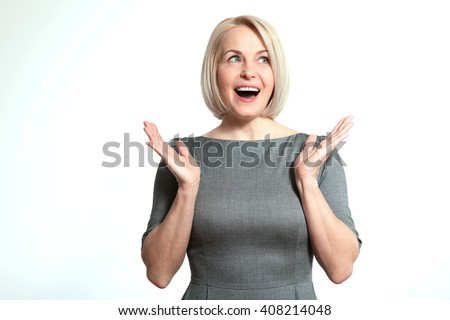 Portrait of happy aged woman. Surprised happy woman looking sideways in excitement. Isolated over white background - stock photo