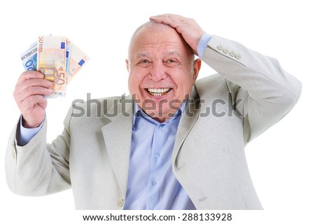 Portrait of Happy and smile old mature businessman in suit, hold euro money in hand and put second hand over head isolated on white background. Positive human emotion, facial expression - stock photo