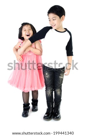 portrait of happy asian boy and girl having fun isolate on white background . - stock photo