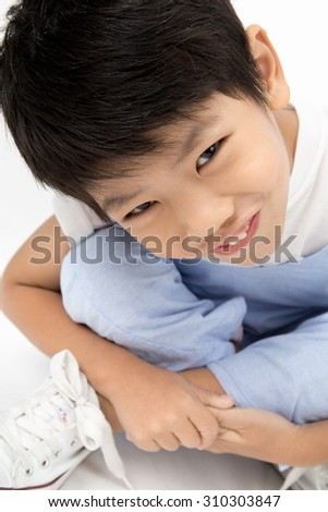 Portrait of Happy Asian boy with smile face on gray background