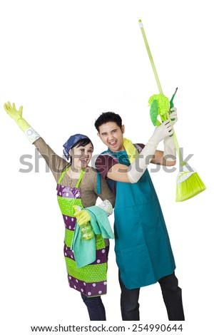 Portrait of happy asian couple with spring cleaning tools, isolated on white background - stock photo