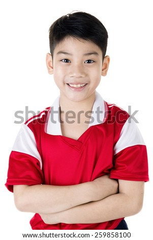 Portrait of Happy asian cute boy in red sport uniform on white background - stock photo