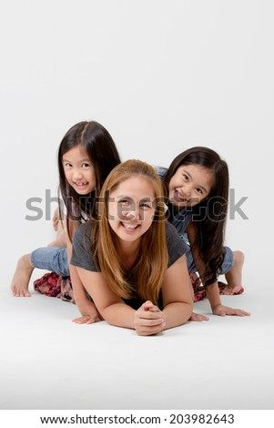 Portrait of happy Asian daughter and mother