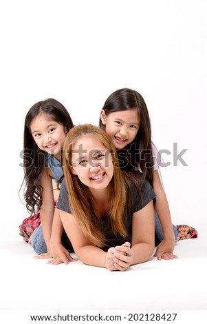 Portrait of happy Asian daughter and mother isolated on white