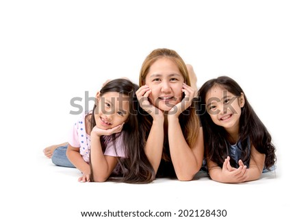 Portrait of happy Asian daughter and mother isolated on white - stock photo