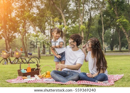Portrait Of Happy Asian Family In Garden ,Beautiful family portrait ,Happy Asian Family In Garden