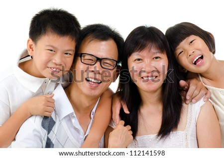 Portrait of happy Asian family isolated on white background - stock photo